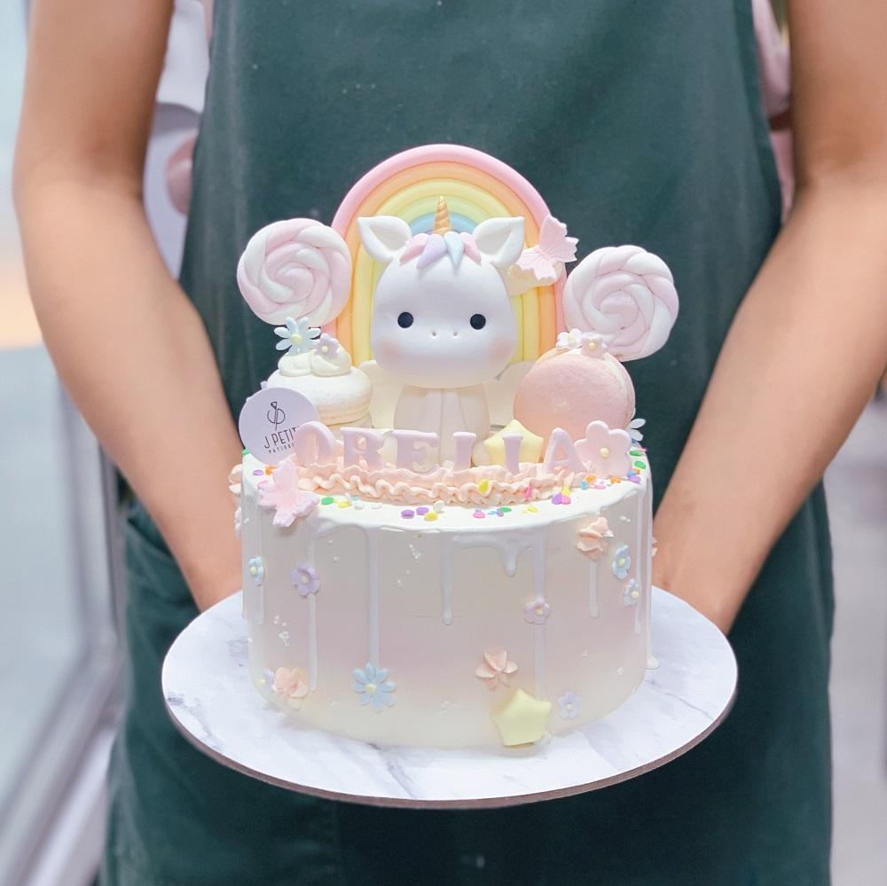 Pastel Candyland with Unicorn and Rainbow Cake
