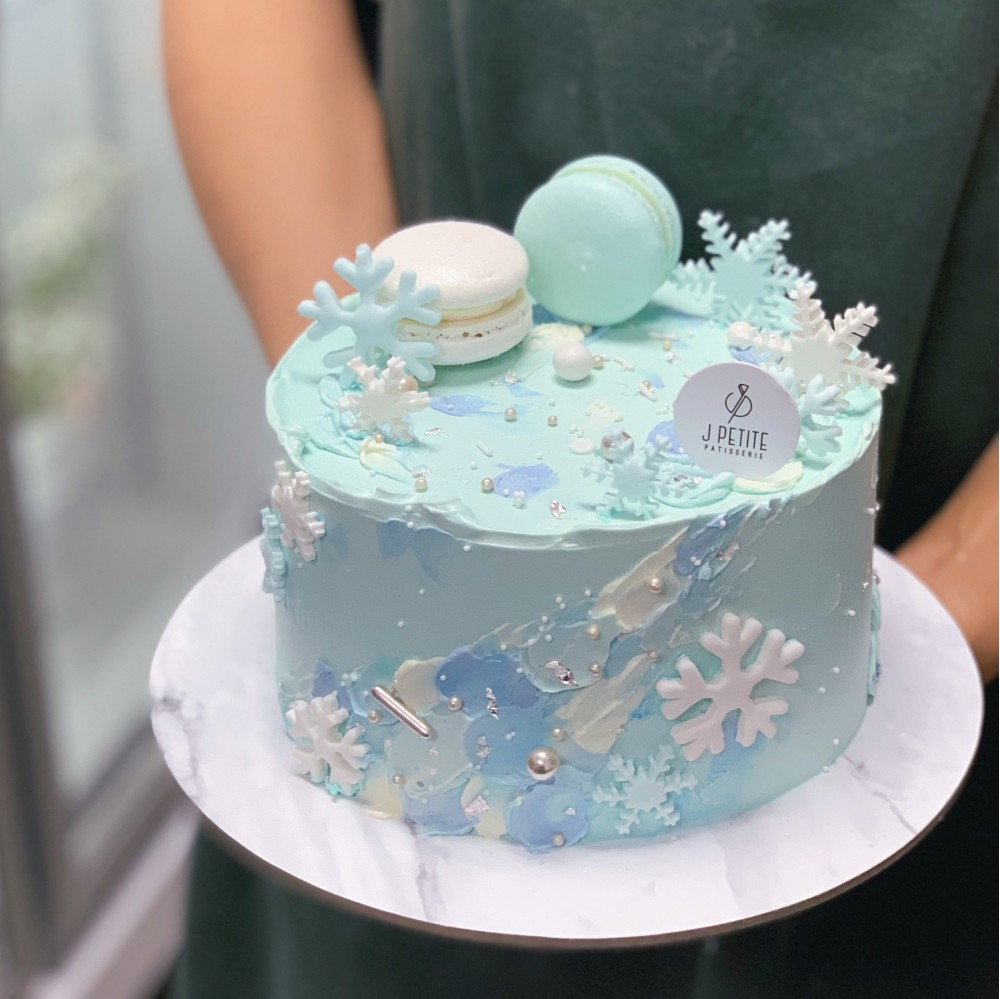 Blue Textured Cake with Macarons and Snowflakes