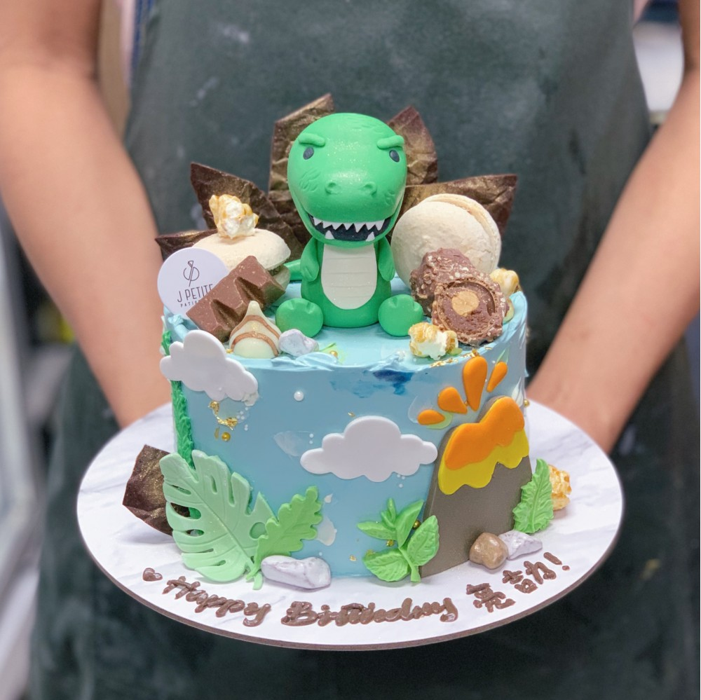 Dinosaur Cake with Volcano and Chocolate Toppings
